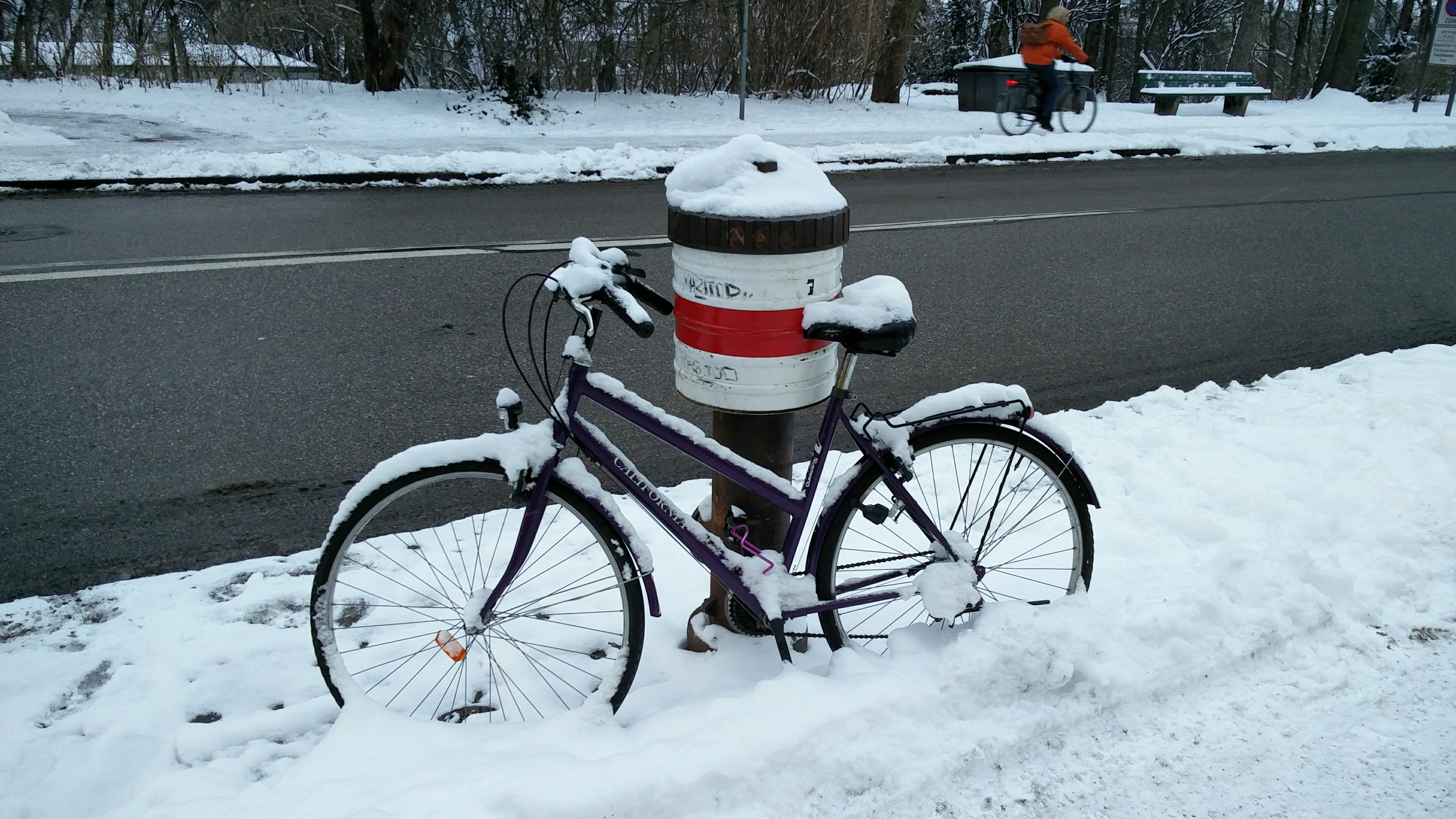 Snow covered bicycle in Munich.